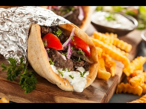 Street Food: Opening And Eating A Gyro